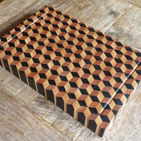 A handmade endgrain cuttingboard with the 3d blocks design. Will last for many years thanks to the knife friendly grain direction and strong waterproof glue used. The boards are finished with a mixture of foodsafe Tungoil and mineraloil.