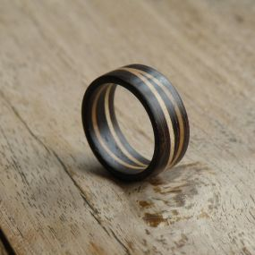 A solid wooden ring for any occasion. From African Wenge and 2 offset rings of Hard Maple. Can be ordered in any size. The width is 10mm or 3/8'' The rings are sold individually.