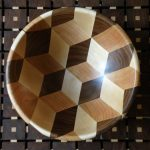 A wooden bowl inspired by Escher, made of American walnut, cherry, and hard maple. Finished with durable coats of danish oil.