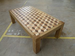 A coffee table with a tumbling block design top. The blocks ( 22mm ) are individually glued on a birch plywood board 3/4'', by hand. Created by Dutch artist Thomas Anton Geurts