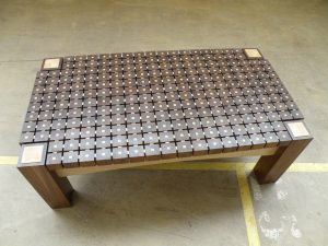 Artistic wooden table. Coffeetable made out of 224 walnut wooden blocks, and maple inlay. Underneath the top is room for magazines. Finished with a durable layer of Danish oil. Dimensions LxWxH 115x60x41cm. 45''x23''x16''.