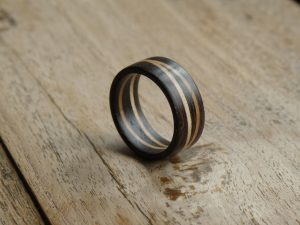 Wood design ring. A solid wooden ring for any occasion. From African Wenge and 2 offset rings of Hard Maple. Can be ordered in any size. The width is 10mm or 3/8'' The rings are sold individually.