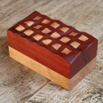 riple box, A 2 part solid wooden box, with wavy carved lid design and square blocks of inlay. Made from Padauk and cherry. Wood art created by the Dutch artist Thomas Anton Geurts